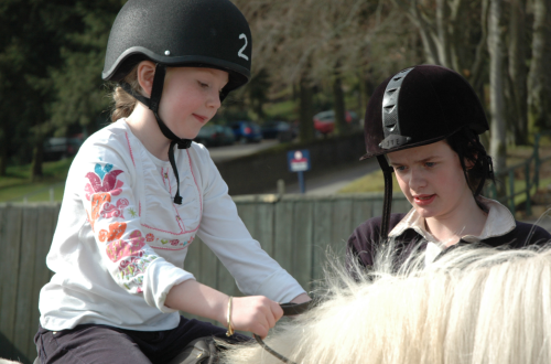 child-learning-to-horse-ride